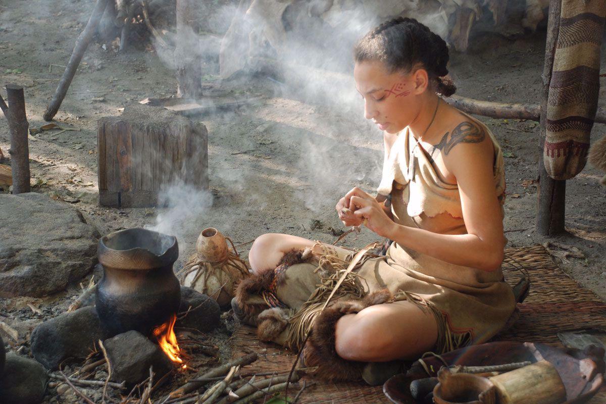 Native woman cooking at Wampanoag homesite
